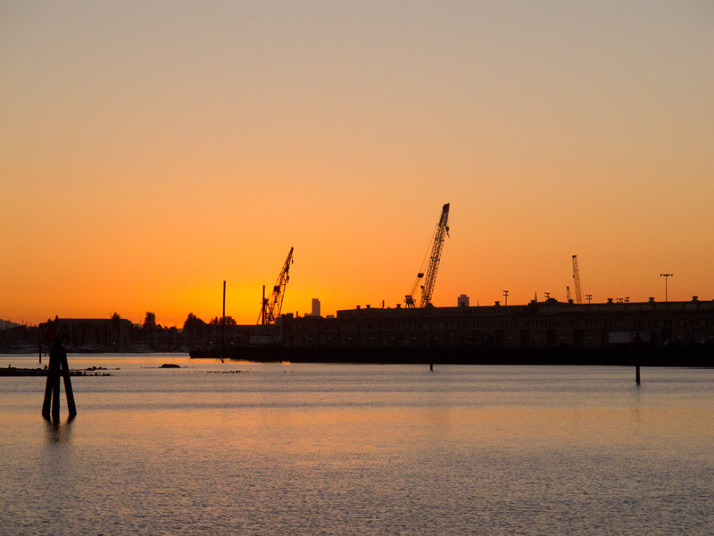 Sunset over the Ninth Avenue Pier, Oakland Estuary.
