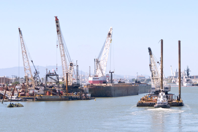 One of Vortex's floating cranes being pushed past the competition opposite Union Point, Oakland Estuary, California.