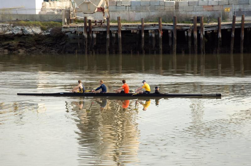 UC Berkeley rowers on the Oakland Estuary near Park Street Bridge