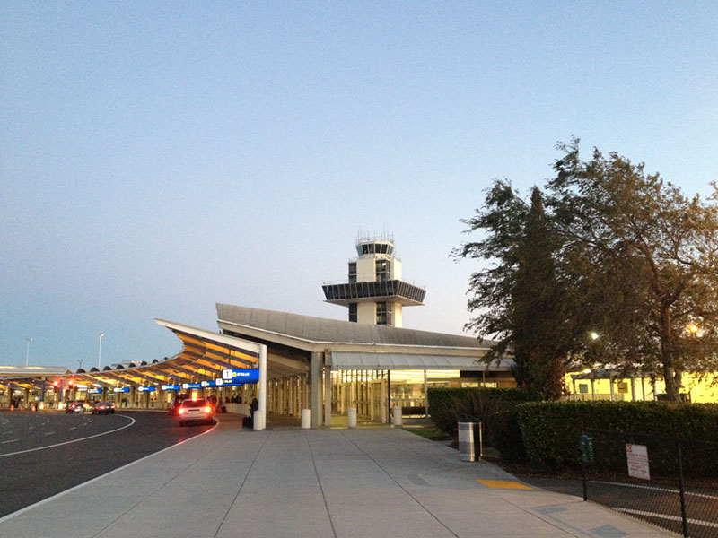 Oakland Airport's classic old control tower and Terminal One.